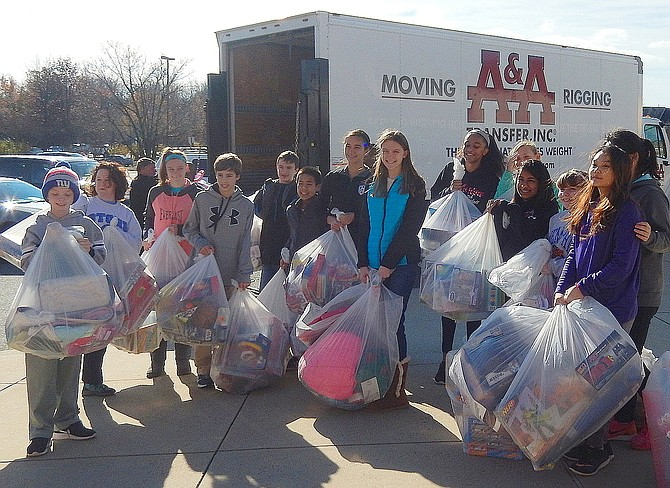 Students load donated clothing into a truck for transfer to ONC's warehouse during last year's gift-drive collection.