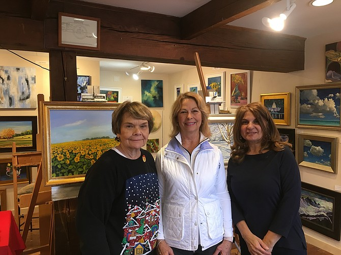 "Coty Dickson, Mary Nesbitt, and Layla Gray of ""Artists on the Green"" pictured in their studio."