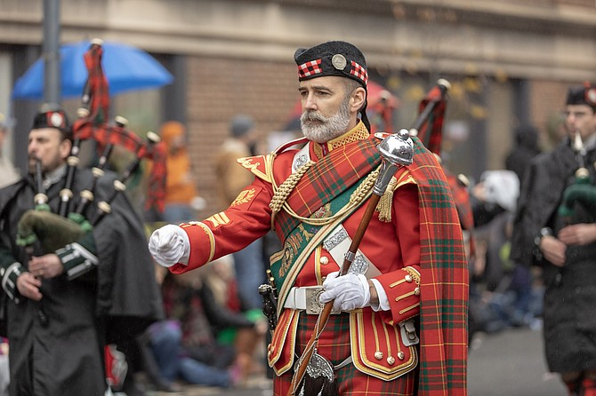 Drum Major Konstantin Gojnycz leads the City of Alexandria Pipes and Drums in the 48th annual Scottish Christmas Walk Parade Dec. 1 in Old Town. The parade is part of the Scottish Walk Weekend of events benefitting the Campagna Center.