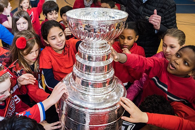 During a brief assembly, students in every grade level had the opportunity to see, touch, and take photos with the Stanley Cup.