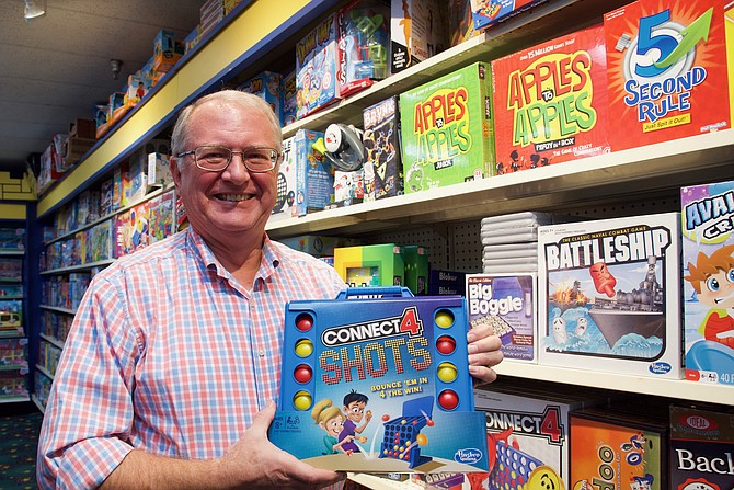 Brian Mack, owner of Toy Castle, displays popular game Connect 4 Shots.