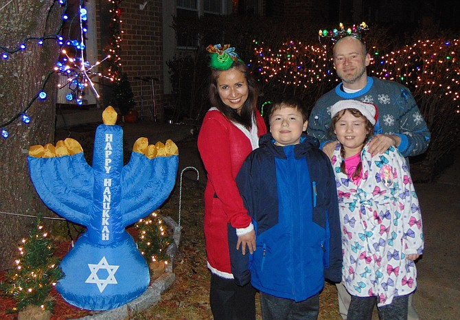 The Schwartz family of New Lakepointe in Burke: mom Maria, dad Elliott, Ethan, 11, and Ellie, 9, with their outdoor decorations.