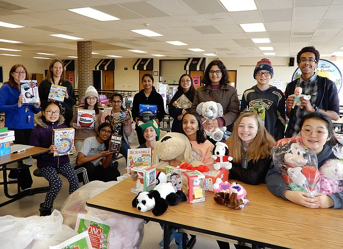 Members of Rocky Run Middle School's National Junior Honor Society, plus co-sponsors (standing, far left) Assistant Principal Christine Sciabica and math teacher Laura Hornberger, pose together after last Saturday's gift collection.