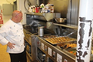 TPC Potomac's Executive Chef David cooks for the sailors on the submarine USS Chicago, where his son Andrew is assigned.