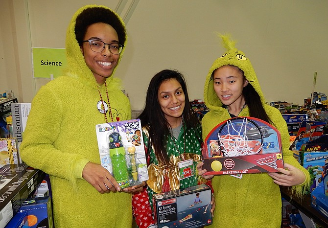 Holding some toys are National Honor Society members from Centreville High (from left) Kyle Foster, Ariana Guillen and Jessica Hong.