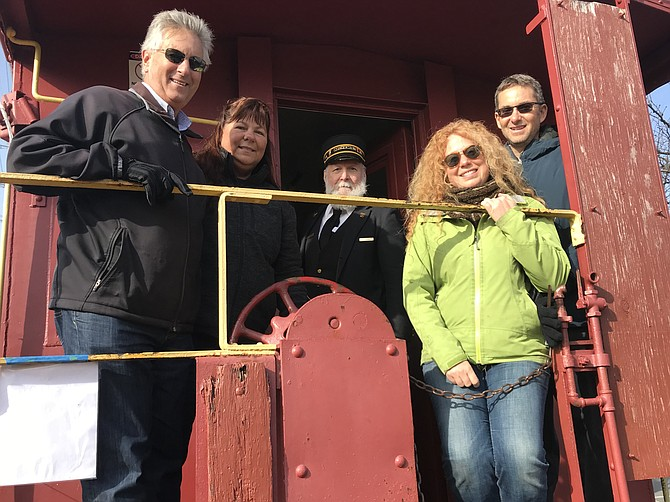 Gregg and Cindy Parks of Gilbertsville, Pa,. join their Herndon relatives Heather and Todd Parks for a tour of Herndon's Red Caboose, during the 13th Annual Herndon Holiday Model Train Show and Caboose/Depot Open House.