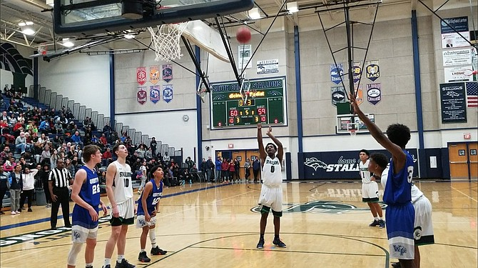 South County junior Will Wilson scored the Stallions' final six points at the free-throw line during an overtime win against West Potomac on Dec. 14.
