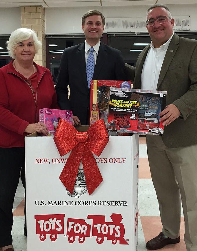 Eileen Brackens (CRWC President), Andrew Lund (AAYR President), and Sean Lenehan (ARCC President) supporting the Toys for Tots program.