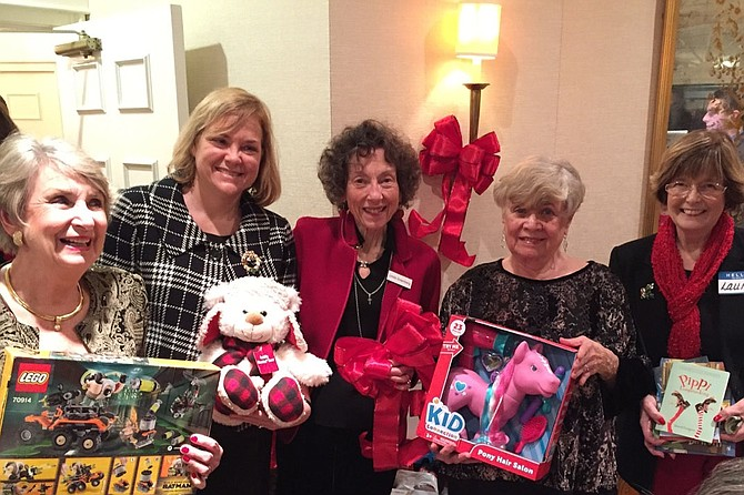 From left: Susie Miller, Susan Fitzpatrick of Community Lodgings, Linda Greenberg, Lois Lipson, and Laurie Kirby as they show a few of the gifts being contributed to the client families of the local non-profit by Commonwealth Republican Women's Club.