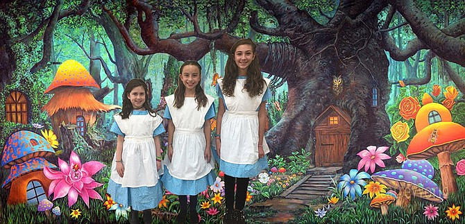 "Bravo Productions presents ""Alice in Wonderland, Jr."" on Saturday, Jan. 19 and Sunday, Jan. 20, 2019 at the Randolph Road Theater, 4010 Randolph Road, Silver Spring. From left are Bravo students: Small Alice (Ayla Gerstenblith from the Charles E. Smith Jewish Day School), Alice (Monica Conroy from Westbrook Elementary School), and Tall Alice (Jordan Block from North Bethesda Middle School)."