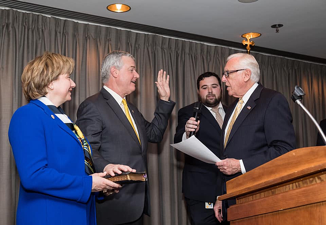 David J. Trone, accompanied by his wife June, is sworn in as U.S. Representative (D-6) by House Majority Leader Steny Hoyer.