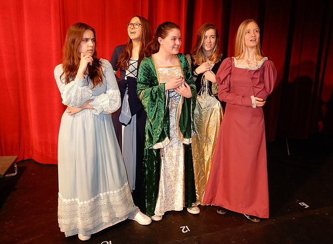 "In Chantilly High's children's play, ""Merry Men,"" Maid Marian (Kaitlin Molloy, center) and her ladies in waiting (from left) Sazana Qeriqi, Anne Blinova, Anna Anderson and Jillian Dalrymple devise a plan."