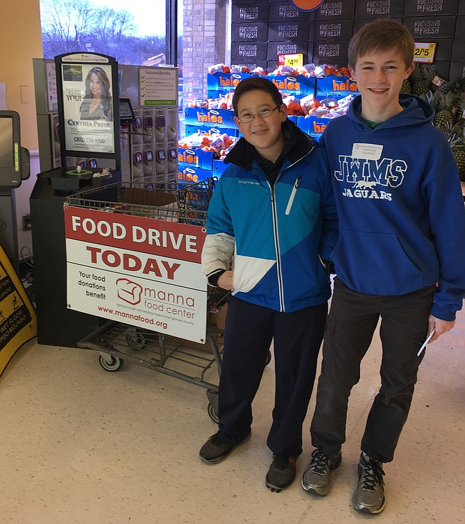 Ryan Whittaker, left, and Sean Borsum greeted shoppers at the Cabin John Giant last year, encouraging donations to Manna Food Center. The boys, both students at Julius West Middle School, volunteered as part of the Montgomery County Day of Service in honor of Dr. Martin Luther King Jr.