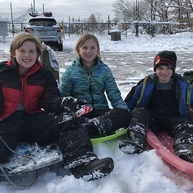 "The Bass children of Reston, Billy, 12, Taylor, 9, and Dylan, 6, prepare to conquer the beast of all sledding hills in the area, ""Mount Reston,"" located at the end of the parking lot behind the Unitarian Universalist Church, 1625 Wiehle Avenue."