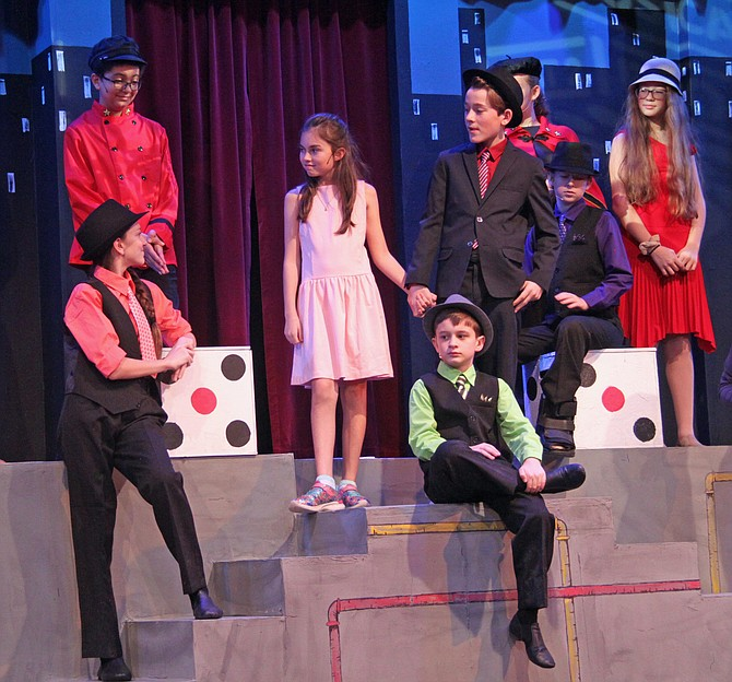 """The cast of ACCT's production of """"Guys and Dolls"""" in rehearsals (from bottom left): Claire Fuller (Benny); Adam Martineau (Arvide); Sophia Stine (Adelaide); Nate Jones (Nathan Detroit); Ellie St. Pierre (General Cartwright); Catherine Weingold (Harry the Horse); Isabella Spooner (Kitty); and Joel Simpson (Rusty)."""