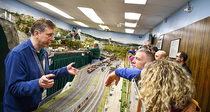Jim Mullison, of Lorton, chats with visitors in the model railroad room.