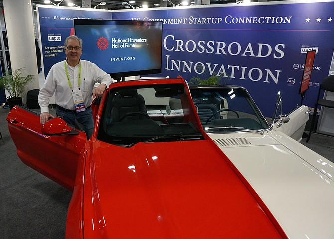 Vince Grecznaik, of the National Inventors Hall of Fame Museum in Alexandria, stands next to the museum's custom Ford Mustang Jan. 11 at the CES 2019 technology show in Las Vegas. The vehicle – a split-model car that merges a 1965 and 2015 model Mustang - demonstrates the progress of automotive design and technology over the course of 50 years. It is scheduled to return to its normal exhibit location inside the museum later this week.