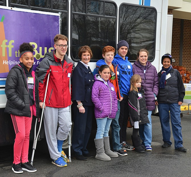 "Fairfax County Board of Supervisors Chairman Sharon Bulova added ""stuff a bus"" duty to her schedule on Saturday, Jan. 19, along with a cadre of county employees, family members, volunteers and staff from the Fox Mill Giant Food Store which hosted the event to benefit nonprofit Helping Hungry Kids."