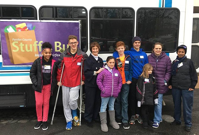 "Sharon Bulova at ""Stuff the Bus"" event on Saturday, Jan. 19, with volunteers who collected food donations at the Giant at Fox Mill shopping center in Herndon."