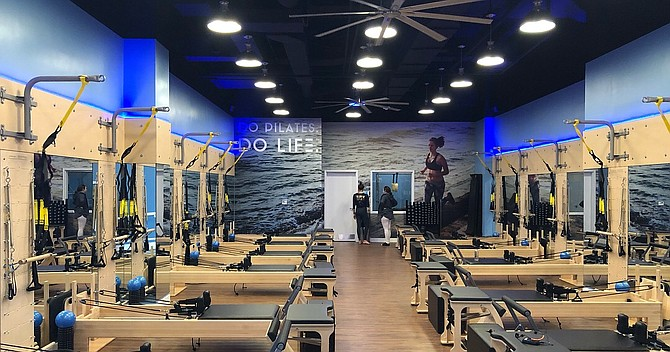 "Club Pilates is now open in Tysons, just off Tyco Road. The second location for owner Michael Grams, the 2,150 square foot facility features the ""Reformer"" method of Pilates, and incorporates a variety of other equipment. ""The instructors are passionate about Pilates and really love to see people gain from the experience,"" said Studio Director Tara Clouse."