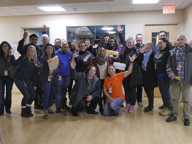 A group of volunteers pauses for a group photo before heading out to begin the 14th annual Arlington Point in Time (PIT) homeless count Wednesday, Jan. 23. This is part of a nationwide effort each year that takes place in January.