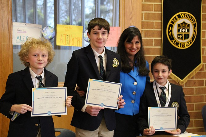 From left: 3rd Place Finisher Francisco Gonzalez-Berrington (6), 2nd Place Finisher Will Lankenau (8), GeoBee Moderator and 5th Grade Teacher Kelly Tanzi, and School Champion Areg Louis Devoyans (5).