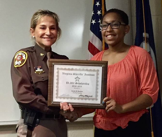 Fairfax County Sheriff Stacey A. Kincaid presents a 2018-2019 Virginia Sheriffs' Institute College Scholarship to Sesaly Barden, a graduate of South Lakes High School in Reston. Scholarship applications for 2019-2020 are available Jan. 31, 2019.