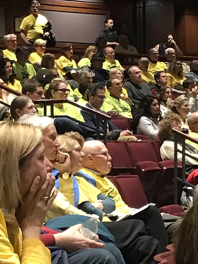 Many audience members at the Public Hearing for the Planning Commission Meeting Jan. 23, on Zoning Ordinance Amendment wear yellow shirts to show their unified opposition to the proposed amendment.