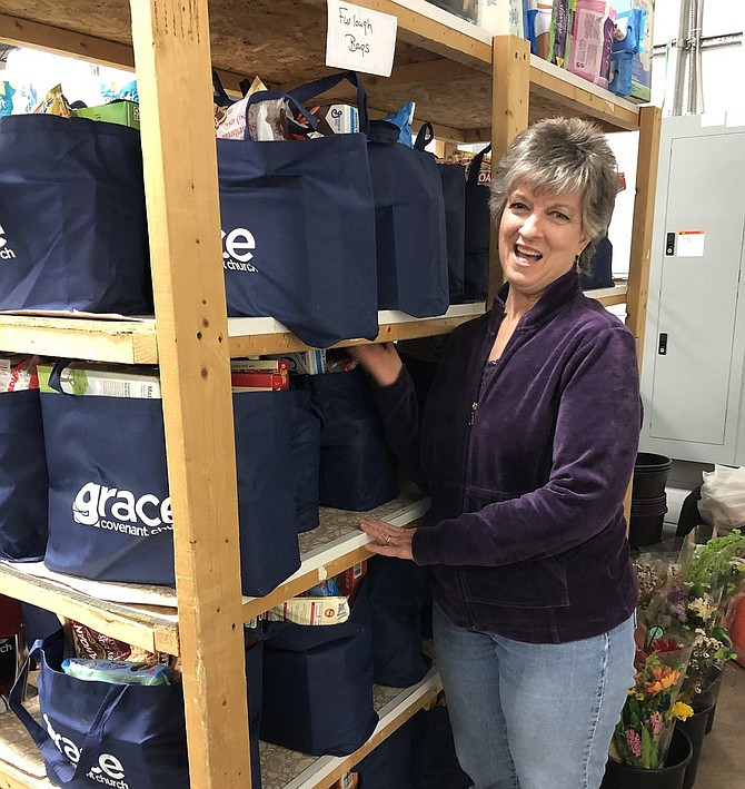 WFCM volunteer Kitty Beachy helped fill 25 bags of nonperishable food to distribute to furloughed government workers.