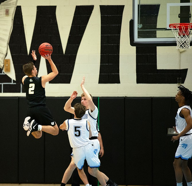 Taylor Morin (2) goes vertical to elevate over two Centreville defenders.