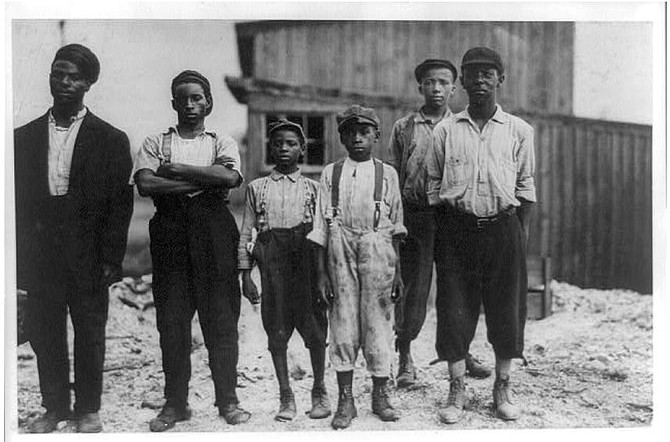 """The Negro Work Force of the Alexandria Glass Factory."" The picture was taken in 1911."