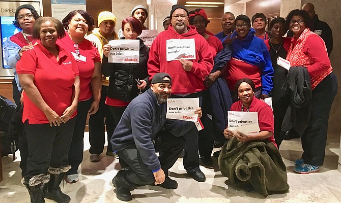 "Public school custodians gave public testimony and held up ""Don't privatize our jobs!"" signs at last week's School Board meeting."