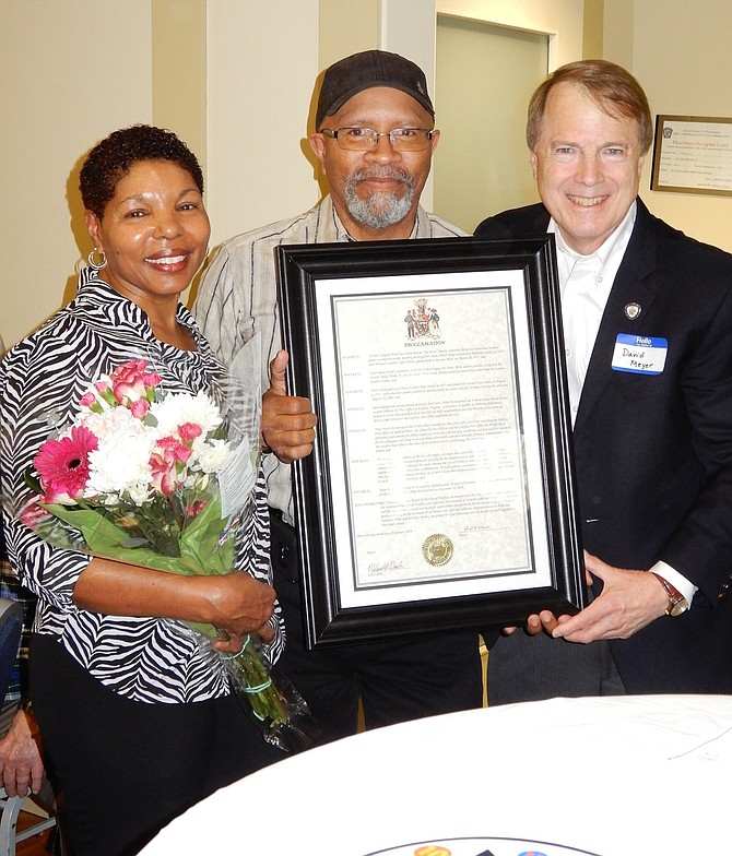 (From left) are Shirley and Mike Ward with Mayor David Meyer and the proclamation of appreciation he gave to former mailman Mike Ward.