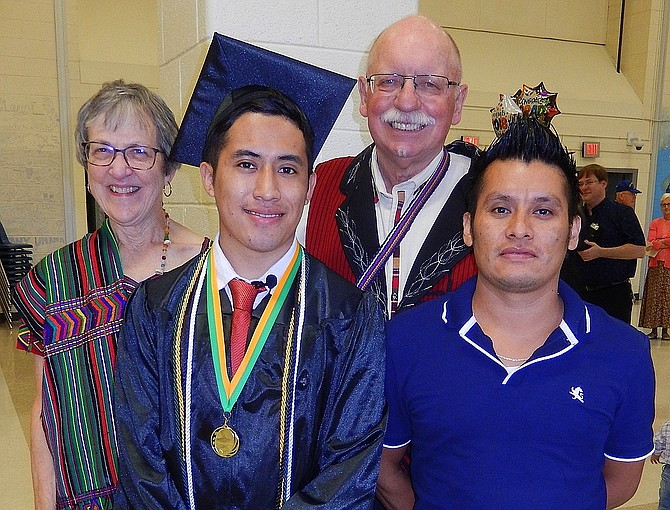 Brayan Brito's June 2018 graduation from Mountain View: Friends Alice and Jerry Foltz with grad Brayan Perez Brito and his brother, Diego Chavez Brito.