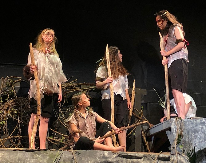 From left:  Bryn Kirk, Carenna Slotkoff, Alexandra Lagos, Kristen Waagner in McLean High School's production of The Lord of the Flies.