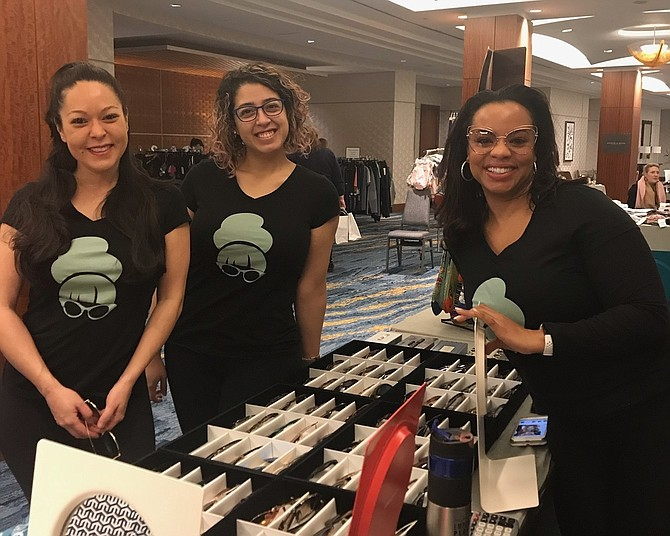 Elizabeth Crull, Andrea Portillo and Mia Suite of eye2eye in Del Ray at the 15th anniversary Alexandria Warehouse Sale Feb. 2 at the Westin Hotel.