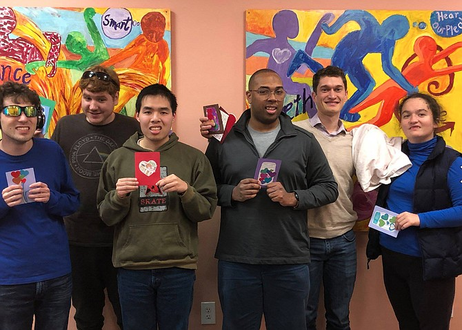 (Second from right) Kevin Barbera, Founder and CEO Barbera Foundation, joins (from left) Ryan McMahon and Ian Nordling of Herndon and Huan Vuong, Ben McGann and Emma Budway of Arlington as they hold a sampling of the 250 handcrafted Valentine's Day cards with personalized greetings they created.