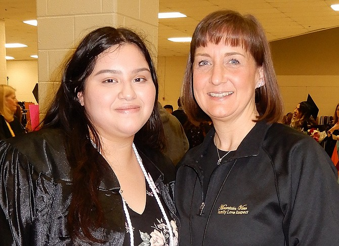 New grad and student speaker Ashley Martinez with school librarian Becca Ferrick.