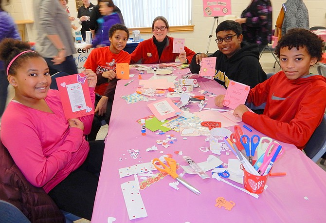 Holding the Valentines they made are (from left) Waples Mill Elementary students Nicole and Eric Holtz Djiba and their mom Sara Holtz, and Franklin Middle students Aaron Selvan and David Holtz Djiba.