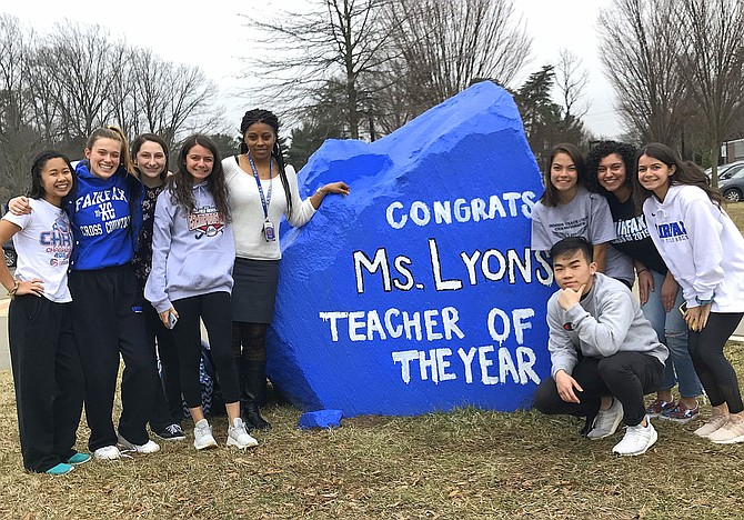 Fairfax High biology teacher Ronnetta Lyons (fifth from left) with some of her students beside the school's brand-new spirit rock donated by the Class of 2019.