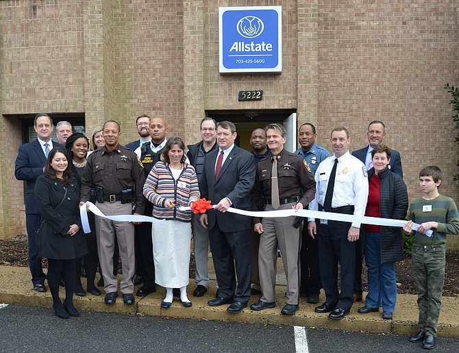 It's official – Springfield Supervisor Pat Herrity helps Robin Hill of Robin Hill Insurance – along with a host of law enforcement, school and community organization partners -  cut the ribbon, making her agency the first to sponsor an Operation Kidsafe Center in Virginia.