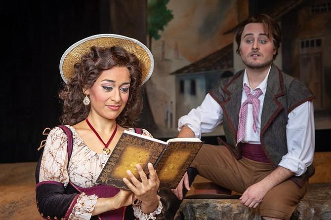 "Cecilia Violetta Lopez as Adina and Carlos Enrique Santelli as Nemorino in the Virginia Opera's ""The Elixir of Love."""