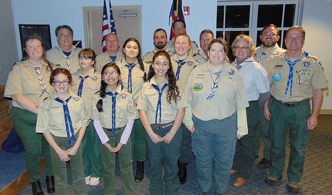 The girls of Troop 893 with their Scout leaders.