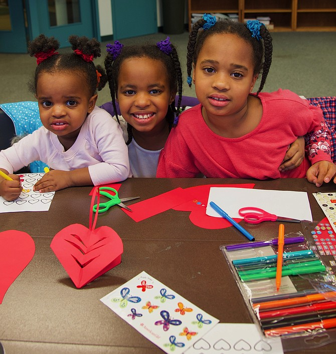 "Harper Leigh, Sloane Avery and Ellis-Marie Coleman Jefferson participate in the Potomac Library's ""Make a valentine"" craft program on Thursday, Feb. 14."