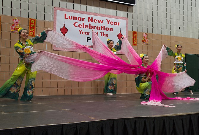 Heather Lee, Wing Lau, Jennifer (Cho) Partlow, and Cathy Chang perform The Ribbon Dance at the Potomac Community Center on Sunday, Feb. 17.