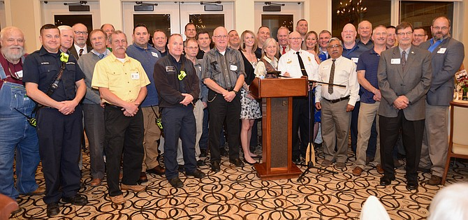 """The """"career"""" personnel, present and past, gather to wish a fond farewell to their retiring volunteer partner, Homer Johns, at the party in his honor."""