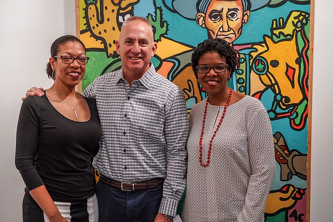 "Marty Schnider, president of Fred Schnider Investment Group, LLC and Founder of the Fred Schnider Gallery of Art, with Allen ""Big Al"" Carter's daughters, Cecilia Carter (left) and Flora O. Stone (right)."