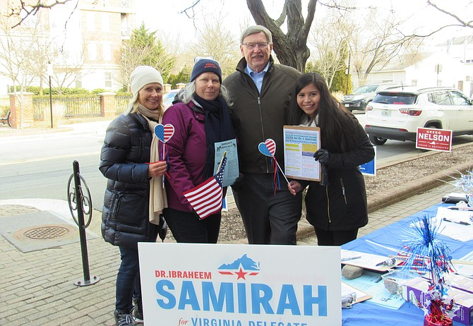 Kat Kehoe of McLean, Kris Gregory of McLean, Fairfax County Board of Supervisors-Dranesville, John Foust (D) and Christy Villalobos of Herndon man the polling station table for Dr. Ibraheem Samirah during absentee voting at the Herndon Fortnightly Library on Saturday, Feb. 16, 2019.