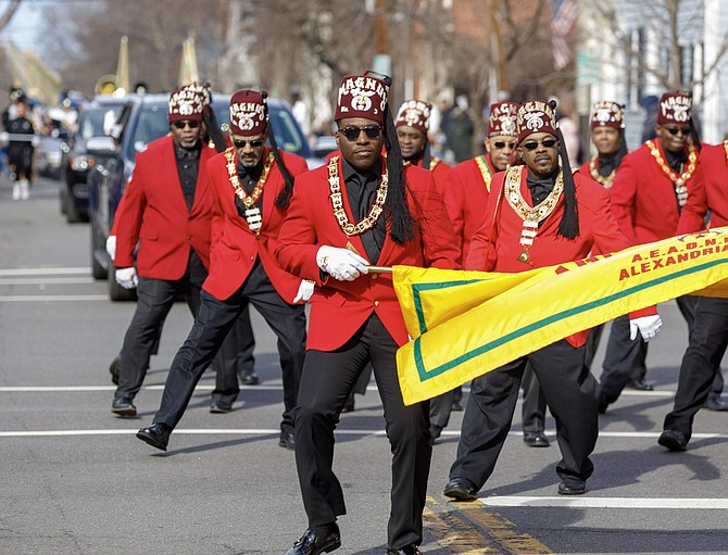 Members of the Magnus Temple 3 Marching Club participate in the 287th George Washington  Birthday parade.