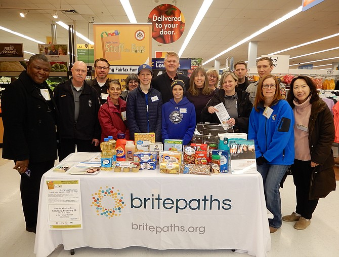 Volunteers from several entities participated in the Stuff the Bus food drive for Britepaths' food pantry. In the center (back row) is Braddock District Supervisor John Cook.